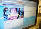 Photo of a student from New York video chatting with students from Andrix's classroom.