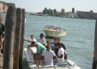 Photo of various members of the Wright State men's basketball team boarding gondullas in Venice, Italy.