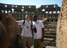 Photo of sophomore forward Cole Darling and senior forward Johann Mpondo posing for a picture in front of the Roman Colosseum.