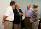 Photo of David Kalsbeek speaking to Rober Sweeney, Berkwood Farmer and Bonnie Mathies.
