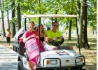 Photo of a freshman girl and her parent on a golf cart.