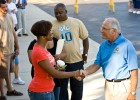 Photo fo President Hopkins greeting students and parents.
