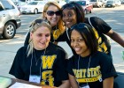 Photo of four student volunteers at a check-in table.