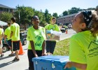Photo of volunteers carrying boxes.