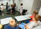 """Photo of students participating in a mock court setting in """"Discovery Court."""""""