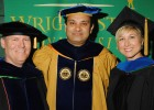 Photo of College of Engineering and Computer Science Dean S. Narayanan and recent Ph.D. graduates.