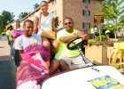 Photo of a freshamn, her brother and father on a golf cart during move-in day.