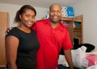 Photo of freshman Tori Simms and her dad Robert Simms in her new dorm room.