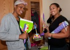 Photo of freshmen Talia Swelo and Natalee Banks showing off some dorm room essentials.