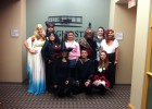 Photo of employees from the office of Communications and Marketing dressed up for Halloween at the office.