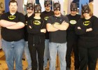 Photo of employees from the Library Computing Services Department each dressed as Batman.