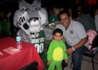 Photo of Renjith George Mathew, his son Johnny and Rowdy Raider at Multicultural Halloween.