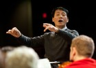 Photo of In-Hong Cha conducting the university symphony during a rehearsal.