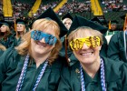 "Photo of two women wearing glasses that say ""2011."""