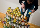 Photo of a man stacking canned food.