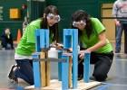 Photo of two students testing their trebuchet