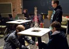 Photo of two students testing their homemade tower