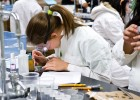 Photo of a student in a lab coat