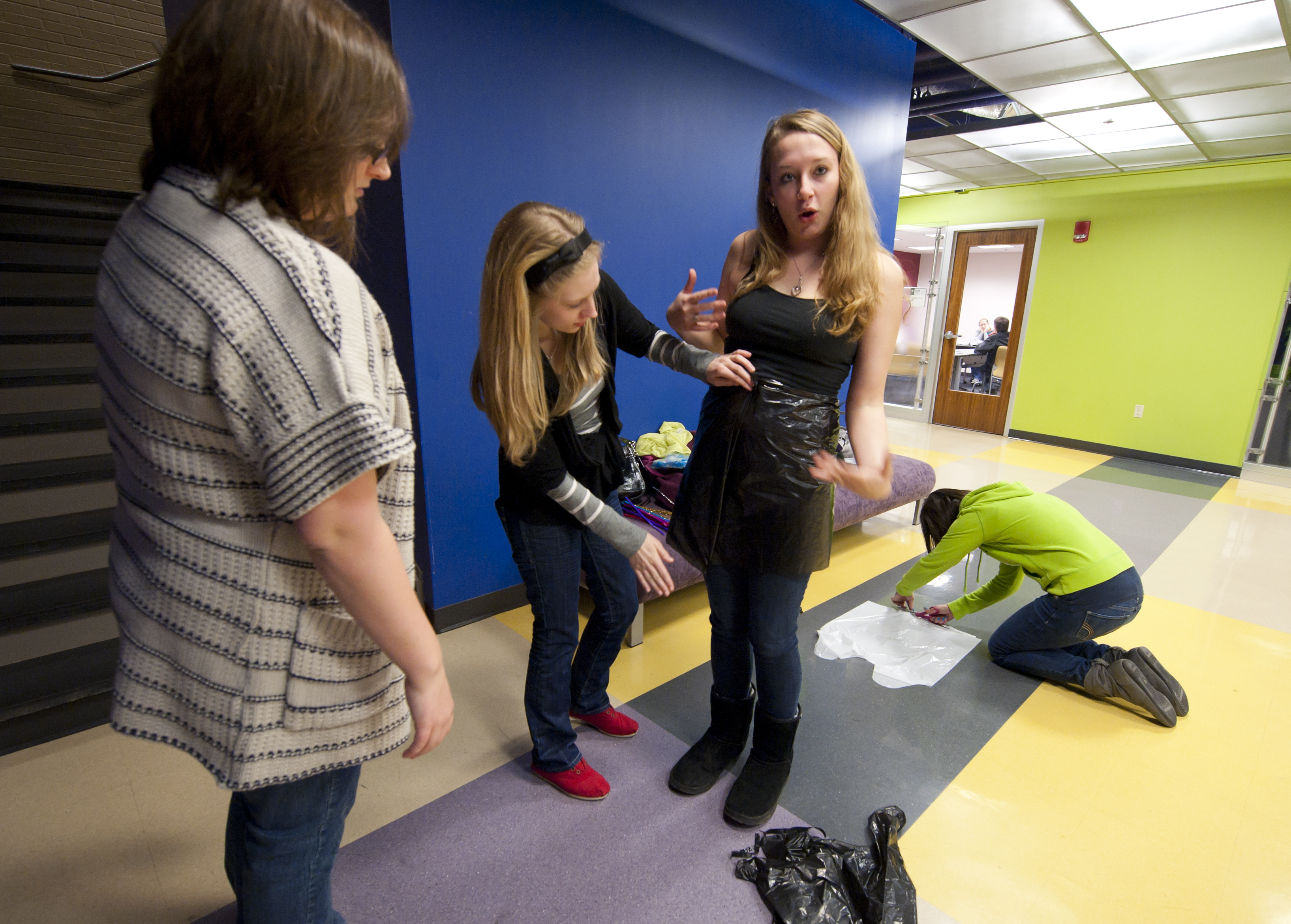 Student tries on trashbag for Project Runway.
