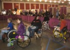 Photo of people usi g wheel chairs in obstacle course