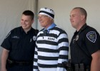 Photo of President Hopkins in fake prison garb for a March of Dimes fundraiser