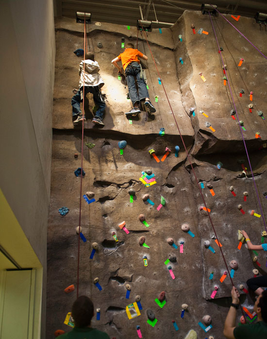 Photo of two youngsters climbing the Wright State Climbing Wall.