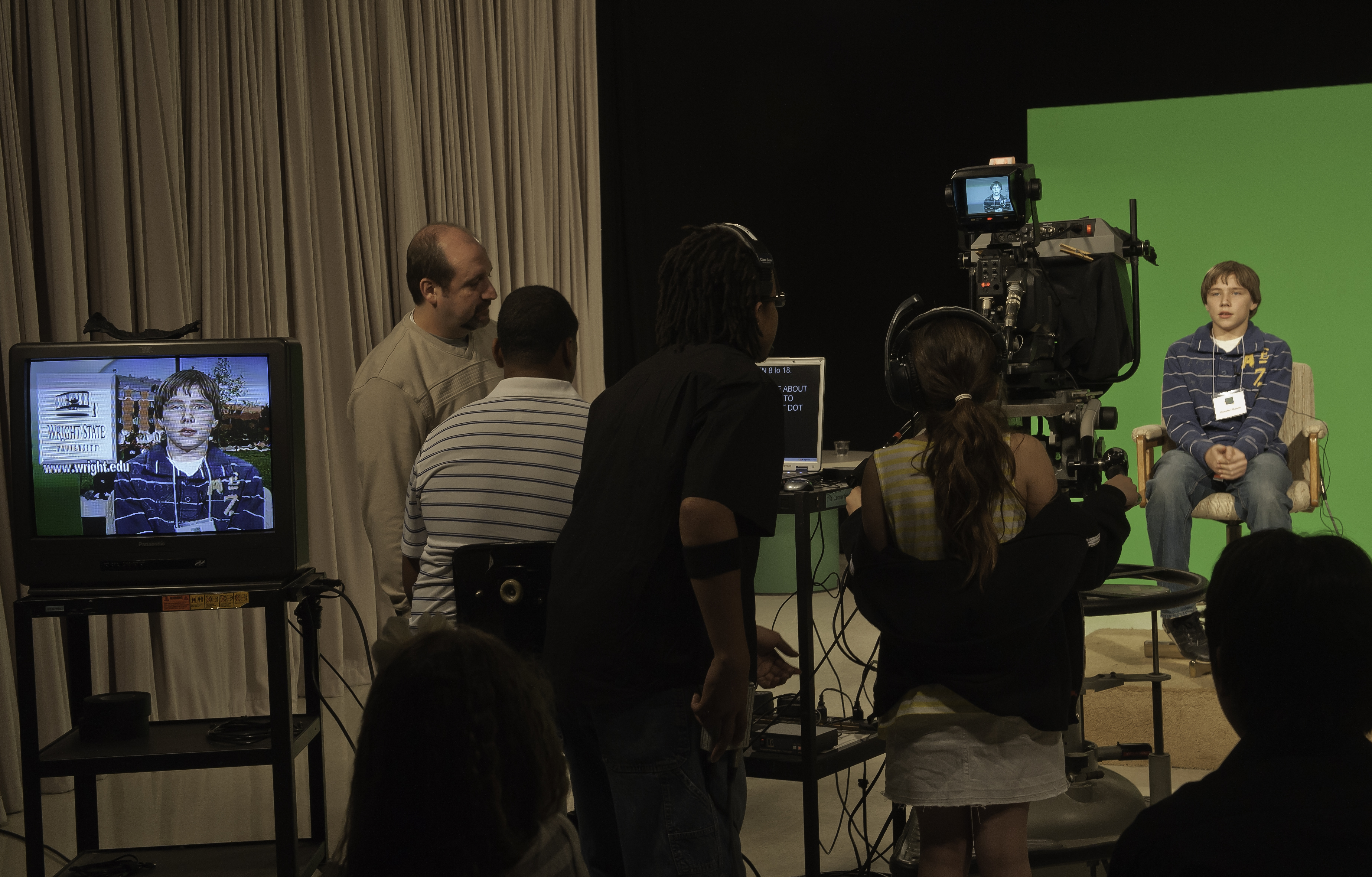 Photo of a boy in the Wright State television studio.