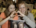 Photo of two girls posing with their personalized Wright State Magazine issue.