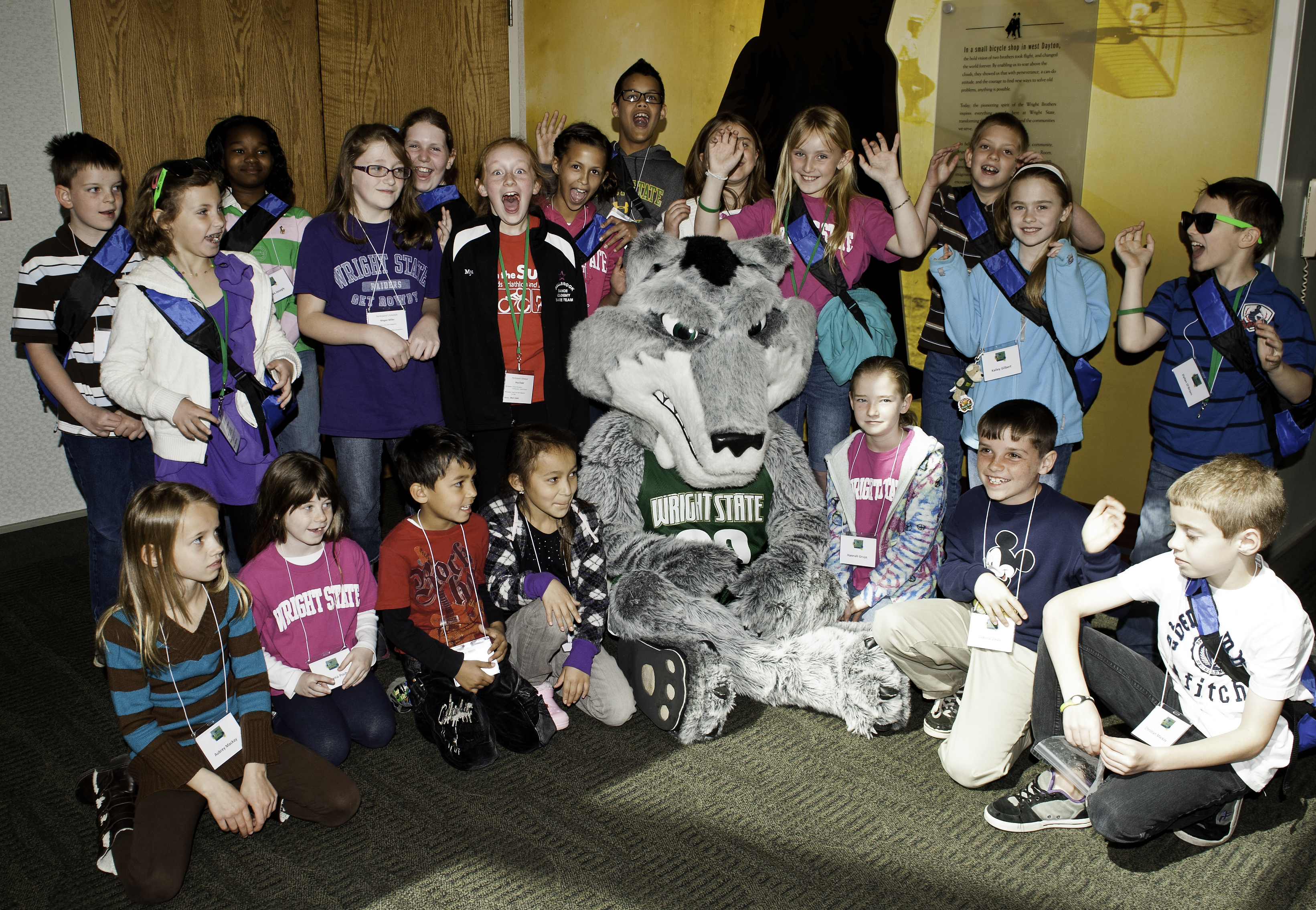 Photo of Rowdy Raider and dozens of kids who participated in the 2012 Take our Daughters and Sons to Work Day at Wright State.