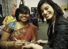 Photo of a Wright State student getting Indian mehndi art decoration on her hand.