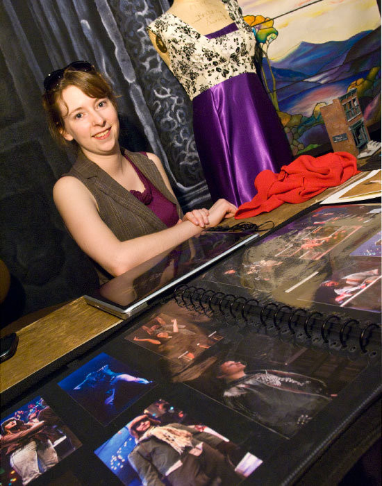 Photo of a female student with photos of costumes