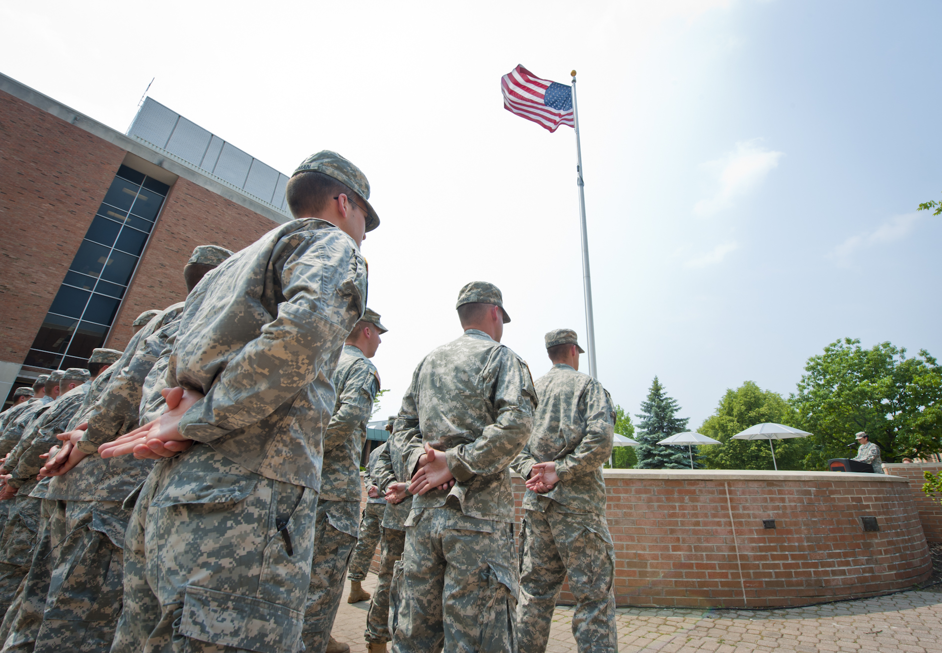 Wright State Army ROTC cadets stand in formation as their commander makes remarks about Memorial Day.
