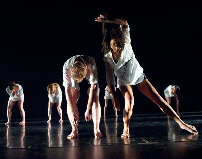 Photo of several dancers in white