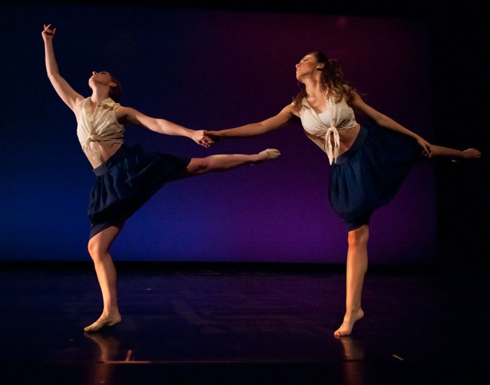 Photo of two dancers holding hands