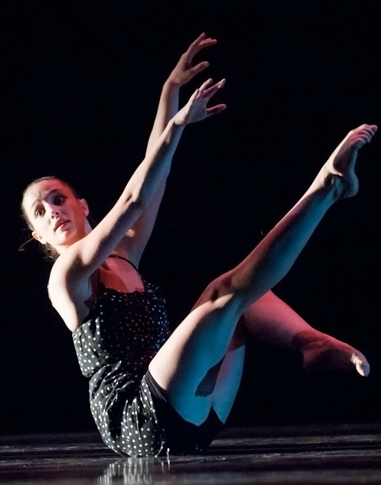Photo of a dancer against a black background