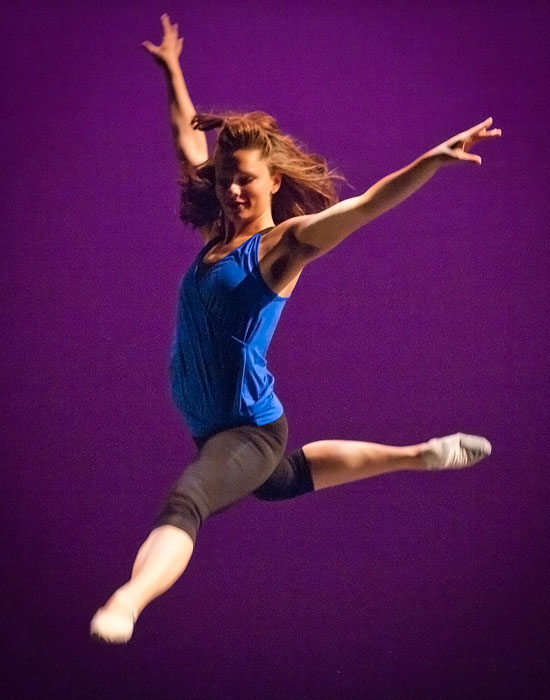 Photo of a dancer leaping.