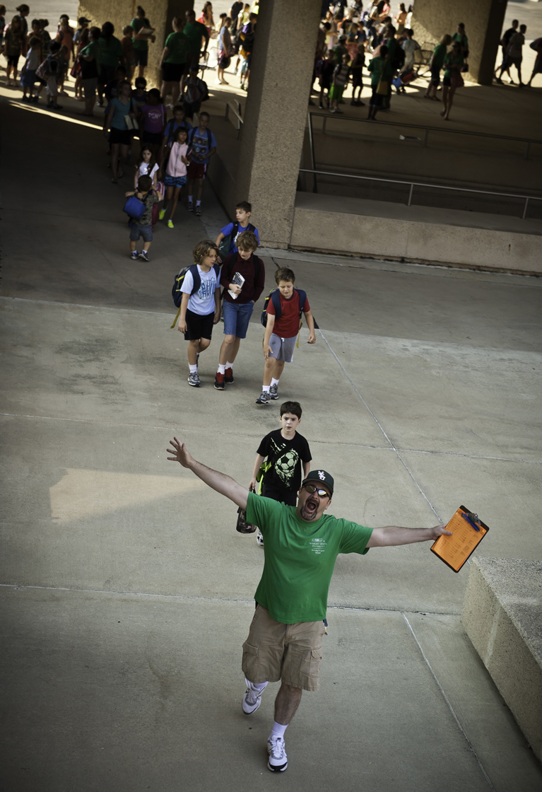 Photo of a pre-college camp instructor leading a class across campus.
