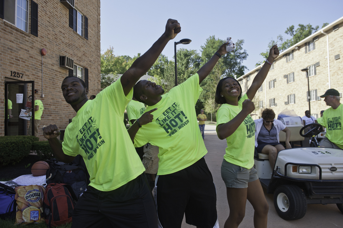Wright State student volunteers strike a pose in homage to Usain Bolt after moving yet another freshman into their new diggs.