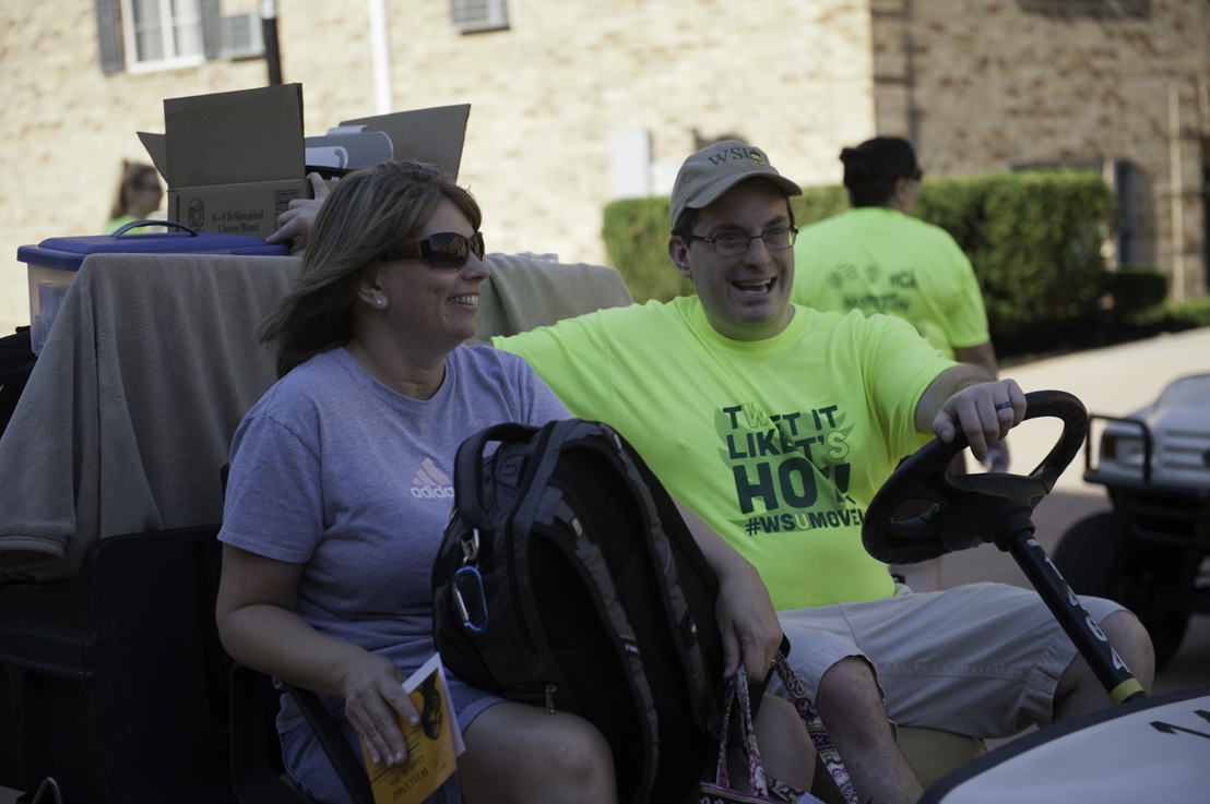 Catching a ride on a golf cart is the way to go on Move-in Day.