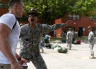 Photo of Derek Oda being instructed by a drill sergeant during his first day at the Leader's Training Course.