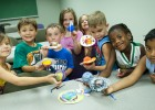 Photo of Star Light Star Bright students showing how they made their own planets like a flower planet, a super earth planet and a rainbow planet.