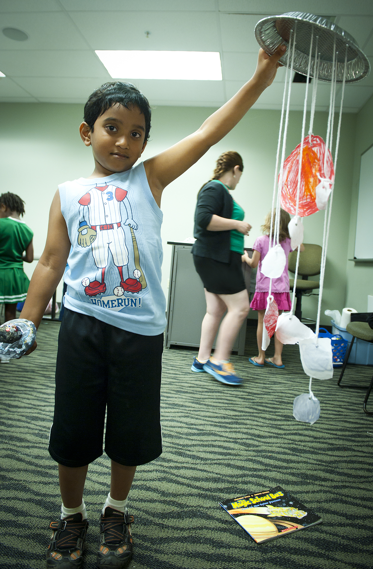 Photo of Aditya Phenaik showing the nifty mobile of our solar system he made in Star Light Star Bright.