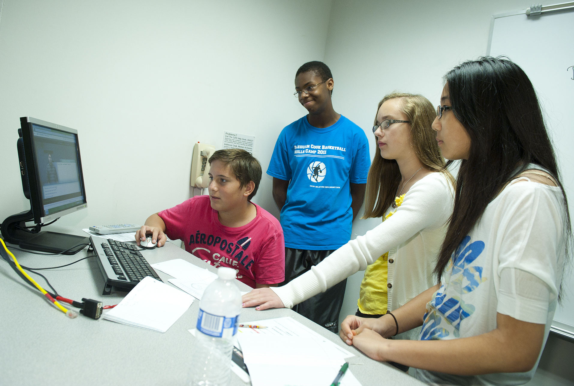 Photo of Collin Clark, Josh McLean, Tristan Pant and Kristine Kim using software to solve a crime in Forensic Analysis camp.