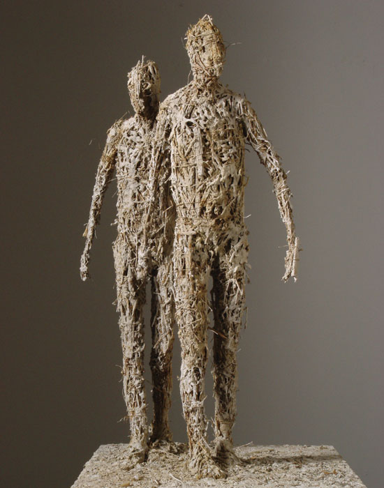 Photo of a sculpture of two people walking