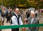 Photo of two men cutting a ribbon