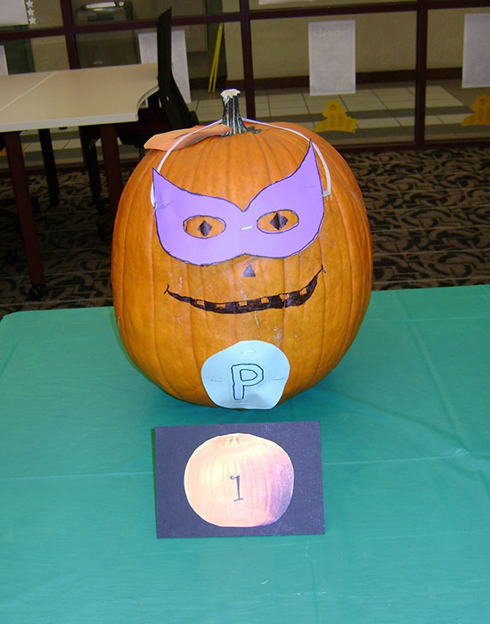 Photo of a pumpkin dressed as a superhero
