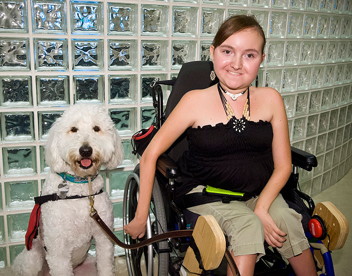 Mallory Holler with her service dog Sparrow