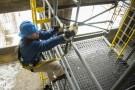 Worker climbing scaffolding