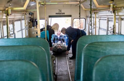 Loading mannequin into school bus