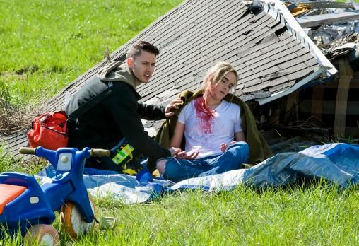A participant assesses an injured survivor